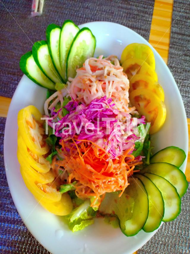 Fresh veggie salad. This one of the healthies food that you can offer to your visitors.