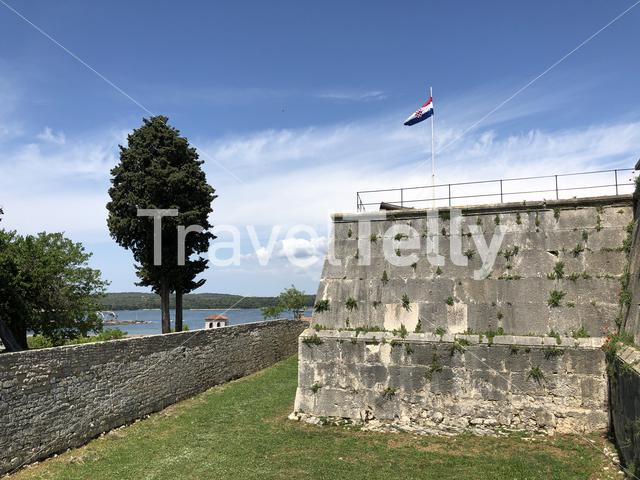Croatian flag on the venetian fortress in Pula Croatia