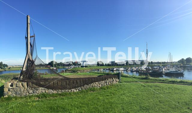 Panorama from a fishing net statue and harbour in Vollenhove The Netherlands