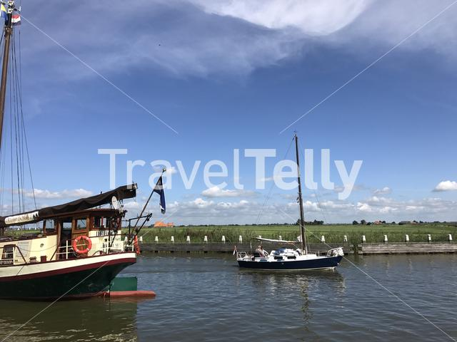 Sailboat at the canal in Sloten, Friesland The Netherlands