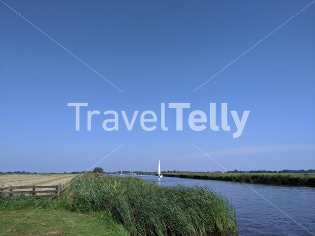 Sailing on a canal in Friesland, The Netherlands