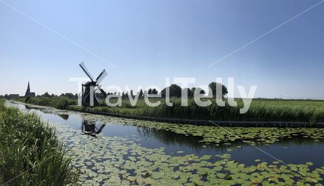 Panorama from old windmill and a canal with seeblatt in Workum Friesland The Netherlands
