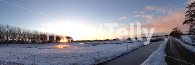 Panorama from a winter sunrise landscape in Sneek, Friesland The Netherlands