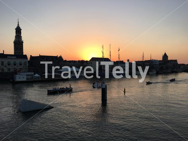 Sunset with boats and the skyline from Kampen The Netherlands
