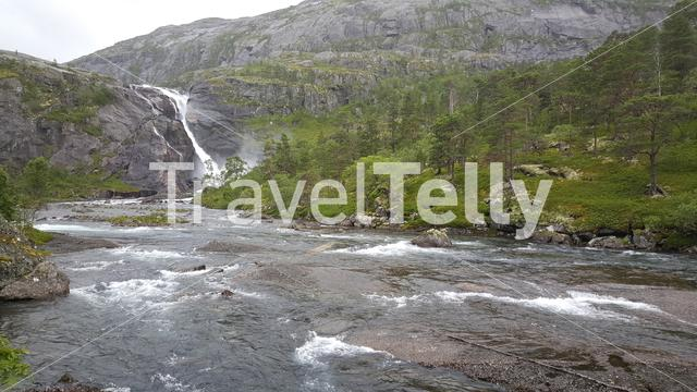 Waterfall and river landscape in Hardangervidda National Park Norway