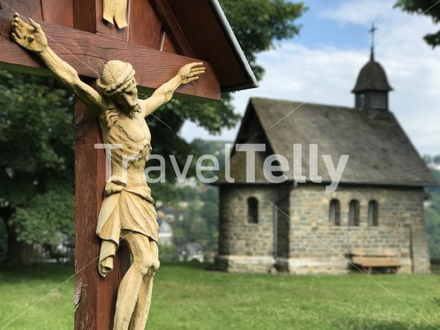 Jesus on a cross in front of a church in Monschau Germany