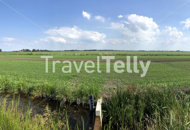 Water level meter at a canal around farmland in Friesland The Netherlands