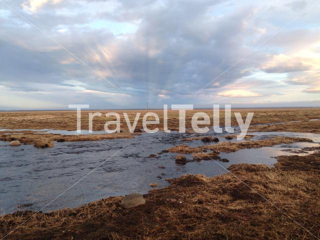 Iceland landscape with melting snow water during sunset