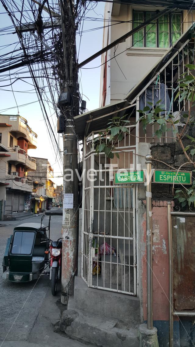 Electricity poles in small street of Manila