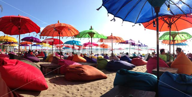 Panorama from colorful parasols at Seminyak beach on the island Bali in Indonesia