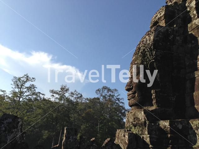 Smiling face carved into stone walls of Bayon Temple in Krong Siem Reap, Cambodia