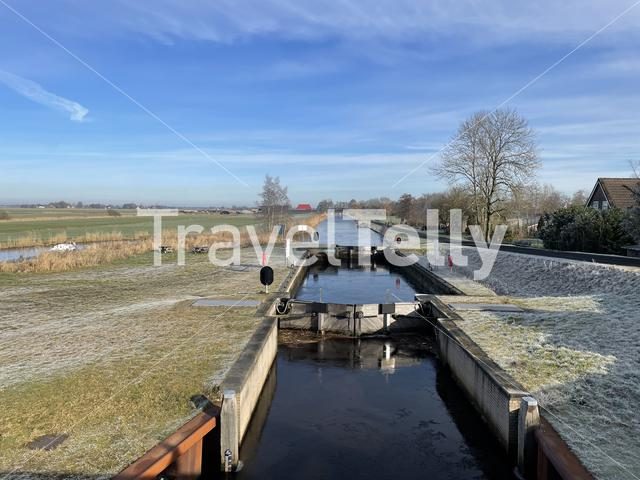 Ice in a canal lock around Nij beets in Friesland The Netherlands