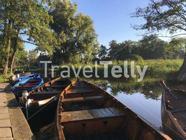 Boats in a canal in Giethoorn The Netherlands
