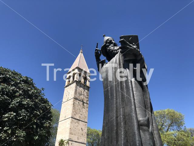 The giant statue of Gregory of Nin and the Chapel of Arnir in Split Croatia