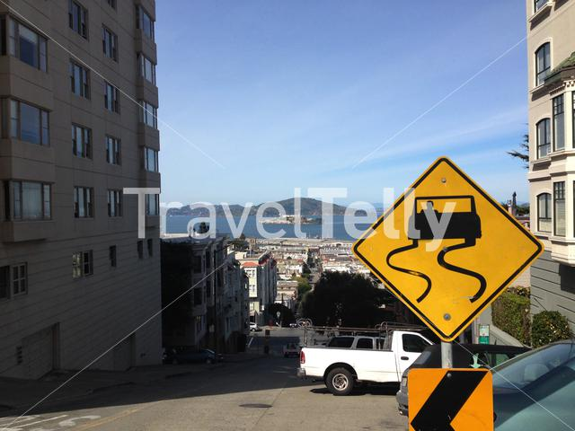Steep hill with Alactraz at the background in San Francisco, United States