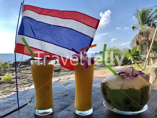 Fruit smoothies with a coconut and the Thai flag in Koh Lanta Thailand
