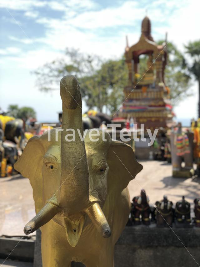 Golden elephant statue at a small temple next to Krom Luang Chumphon Monument in Phuket Thailand