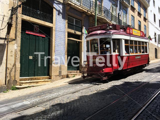 A red tram in the streets of Lisbon Portugal