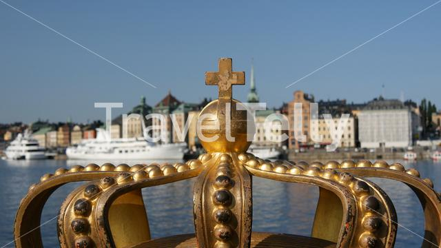 A golden Royal Crown on the Skeppsholmsbron bridge in Stockholm, Sweden