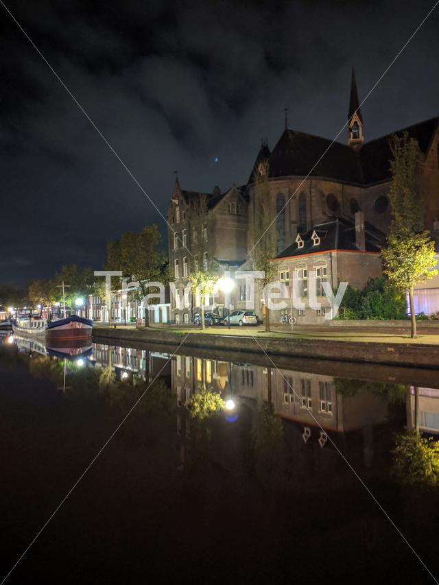 Church along the canal at night in Sneek, Friesland, The Netherlands