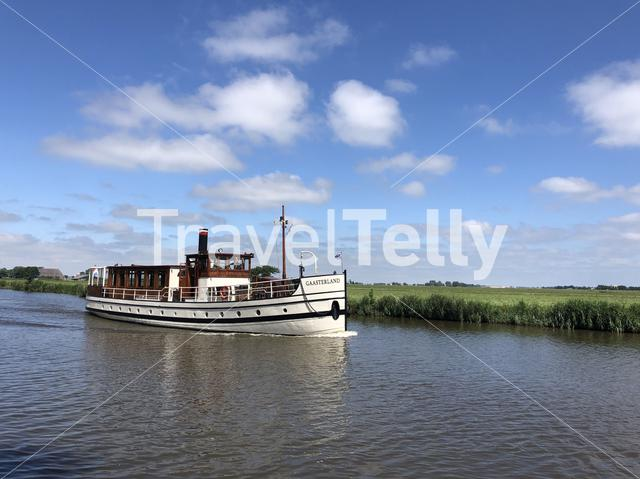 Classic tourism ship at the canal Dokkumer Ee in Friesland, The Netherlands