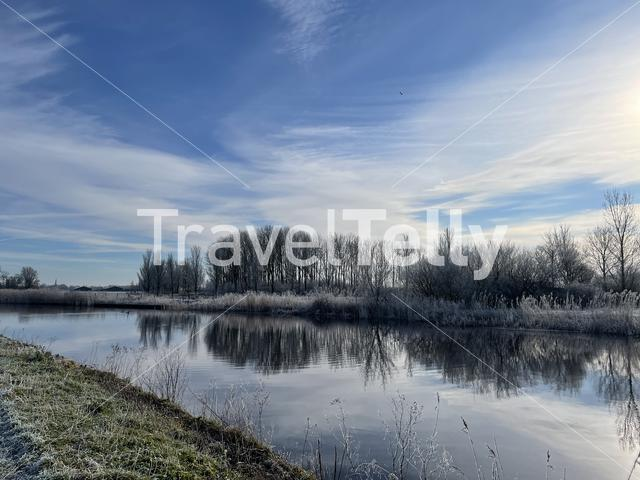 Road next to a canal around Nes during a winter day in Friesland The Netherlands