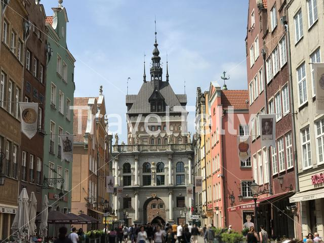 People in the street of Gdansk with the golden gate