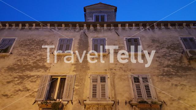 Old house with awnings in Rovinj town, Croatia