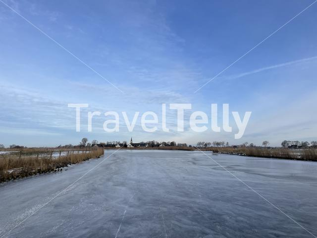 Ice skating on a frozen lake around Oosthem in Friesland The Netherlands