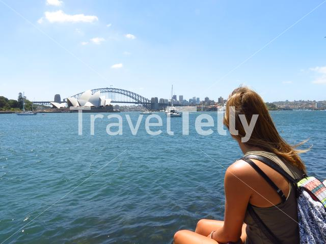 Girl at the botanic garden looks to the Sydney Opera House