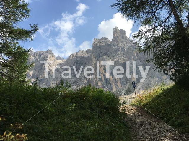 View of mountain peaks while hiking near Wolkenstein (Selva) in Val Gardena (Gröden), Dolomites, Italy.