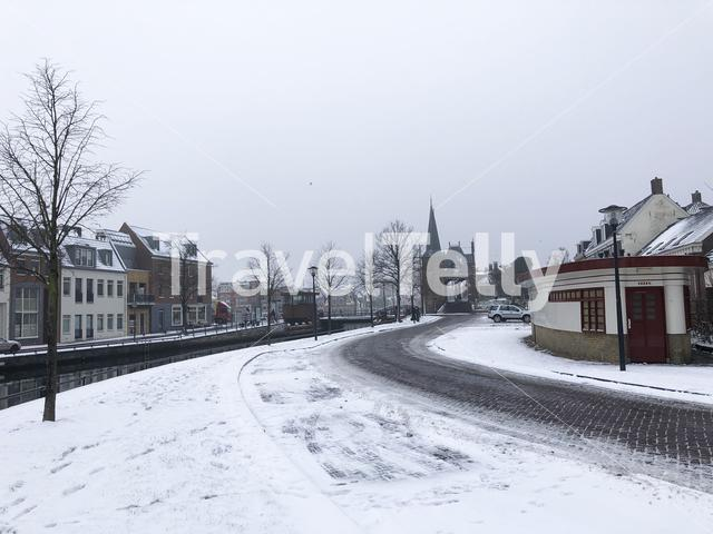 Snowy road towards the watergate in Sneek, The Netherlands