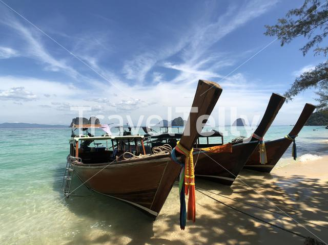 Long-tail boats on the beach of Koh Ngai in Thailand