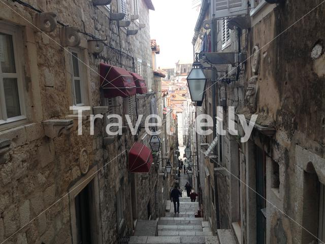 Narrow alley with old houses in Dubrovnik Croatia