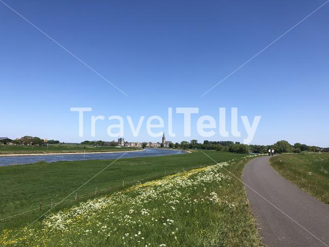 Cycling along the river IJssel towards Doesburg in Gelderland The Netherlands