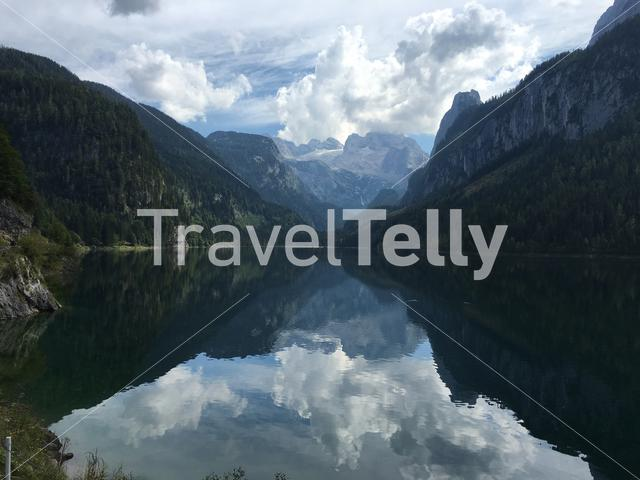 View over the Gosausee in Austria. The mountains are reflected in the lake.