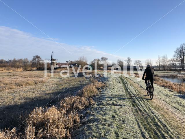Cycling through winter landscape around Wolvega in The Netherlands