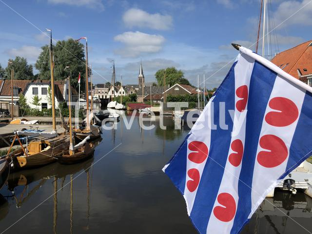 Canal with the Frisian flag in Heeg, Friesland, The Netherlands