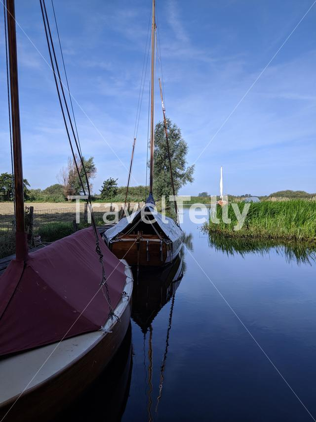 Sailboat in a canal around Langelille, Friesland The Netherlands