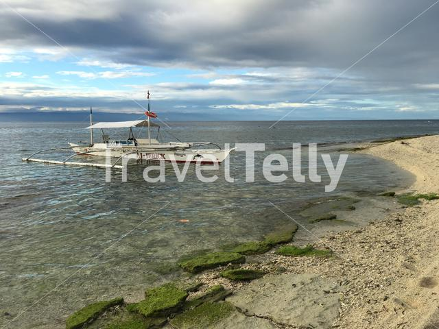 Catamaran Boat in close to the beach at Balicasag Island in Bohol the Philippi