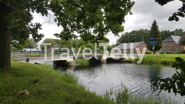 Small bridge over river in Beemte Broekland, countryside in tbe Netherlands