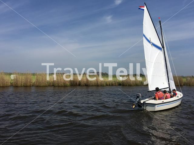 Sailboat in the Jeltesleat in Friesland The Netherlands