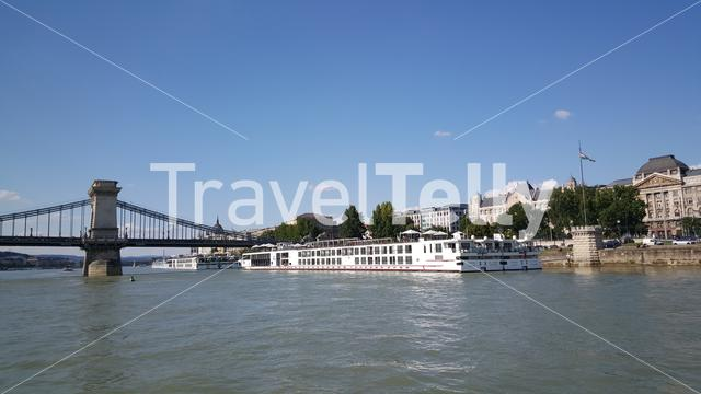 View from a ferry at the Széchenyi Chain Bridge is a suspension bridge that spans the River Danube in Budapest Hungary
