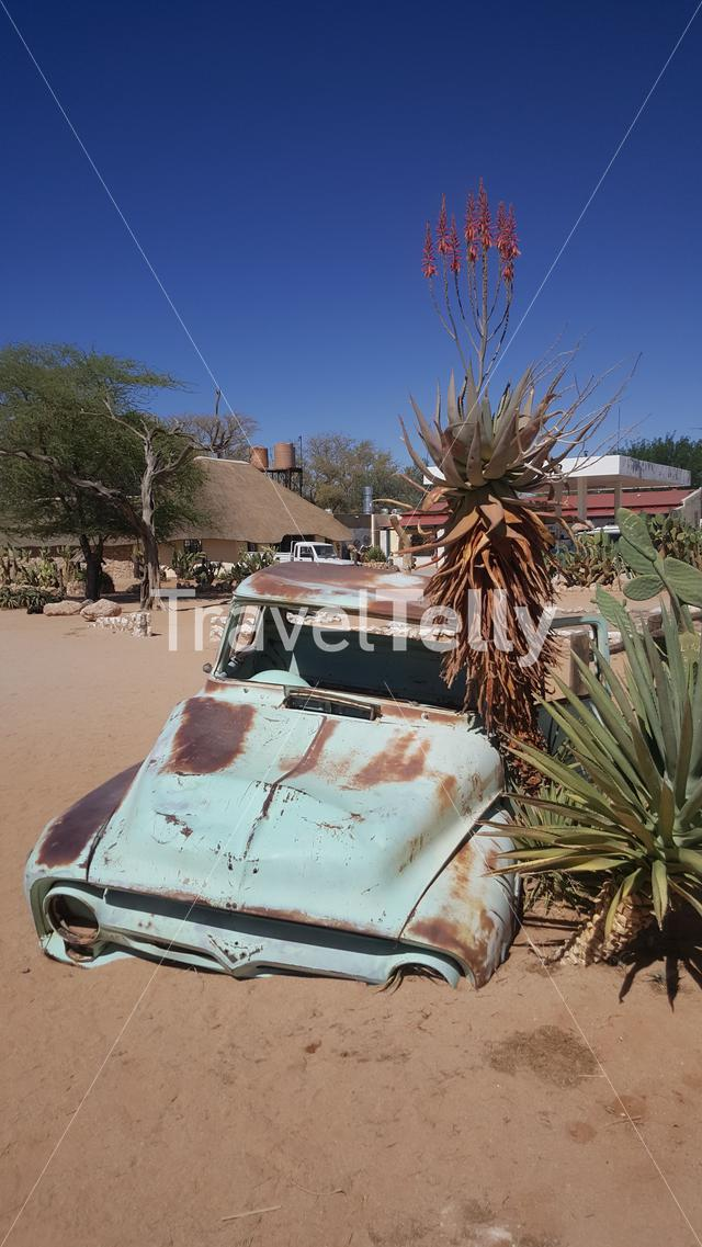 Old car wreck at Gas station Solitaire in Namibia