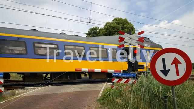 Train passing by at Railway transition in Dutch landscape