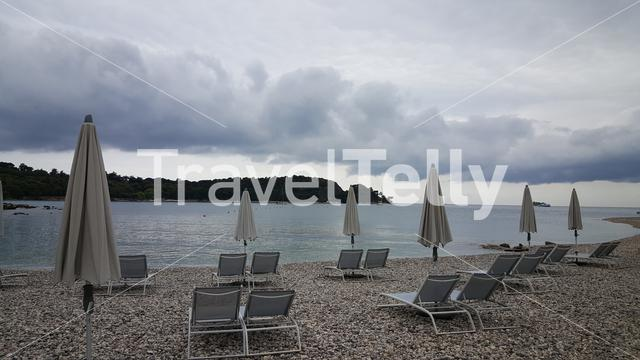 Empty sunbeds at cloudy day near waterfront Croatia