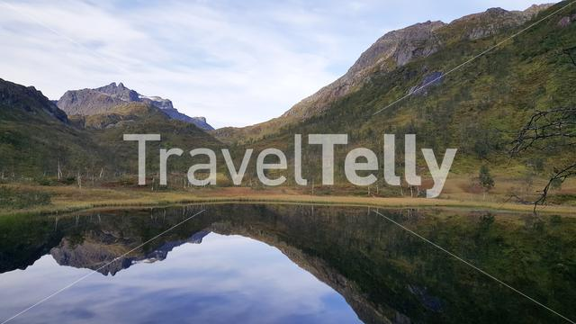Mountain reflection in a lake at Moysalen National Park Norway