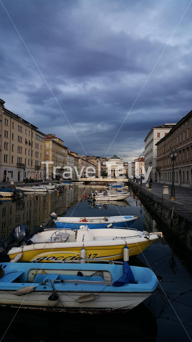 Houses and boats at Ponte Rosso canal in Trieste, Italy