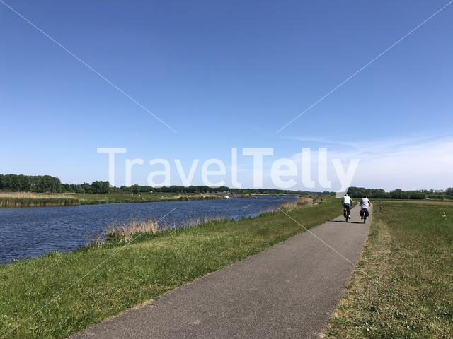 Tourists cycling along the old IJssel around Doesburg in Gelderland, The Netherlands