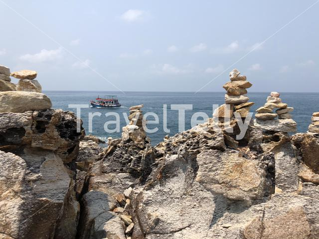 Stones at koh samet end view point with a boat in the background